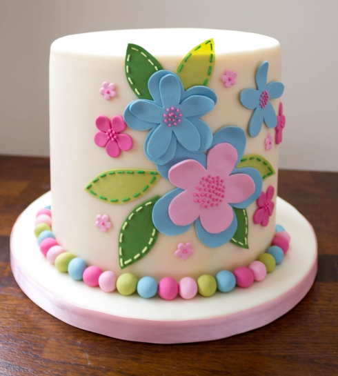 Pretty pink, green and blue cushion inspired celebration cake